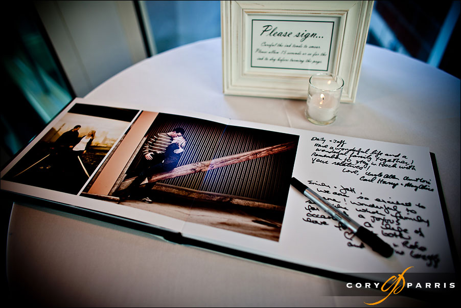 guest signing photograph book by seattle engagement portrait photographer cory parris