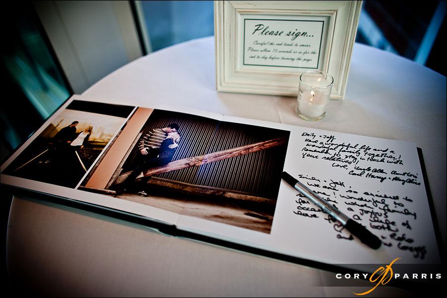 guest signing photograph book by seattle engagement portrait photographer cory parris