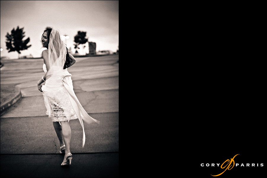 bride running from the rain by seattle wedding photojournalist cory parris