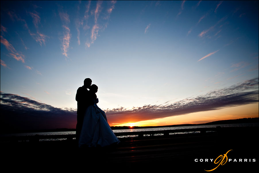bride and groom at sunset on the shores of lake washington by seattle wedding photographer cory parris