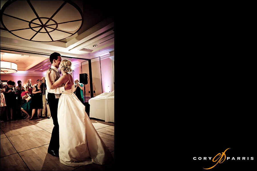 bride and groom first dance in the ballroom at the woodmark hotel by seattle wedding photojournalist cory parris