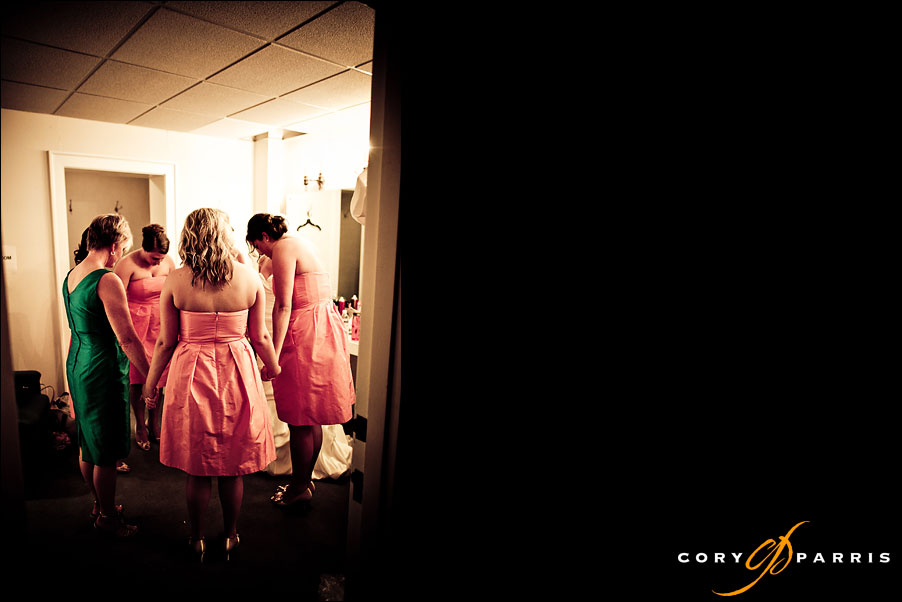 bride and bridesmaids praying at mount baker presbyterian church by seattle wedding photojournalist cory parris
