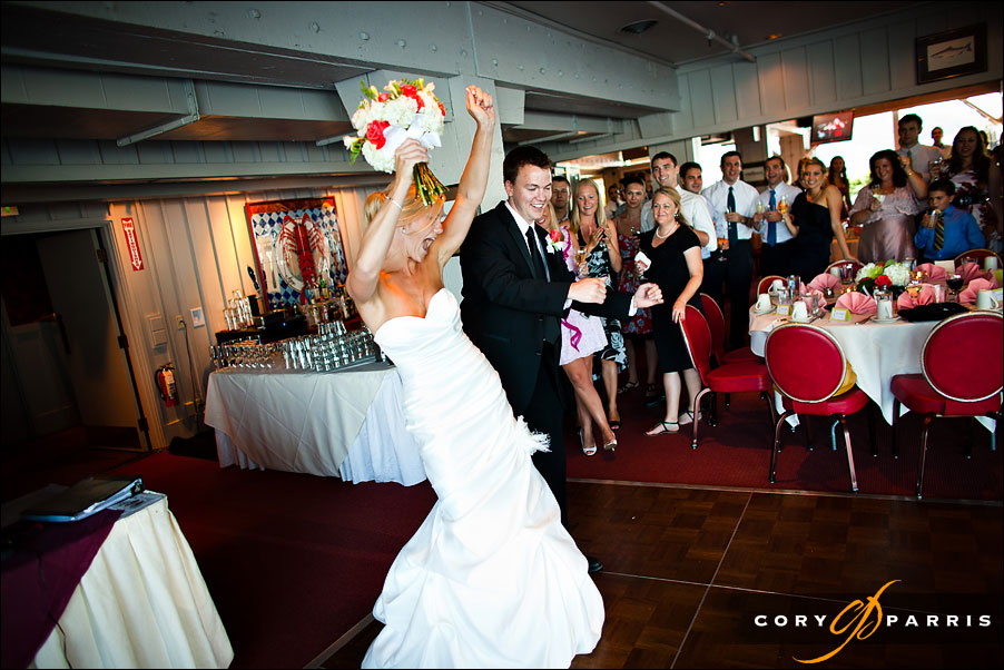 bride and groom making their grand entrance to the reception at salty's on alki