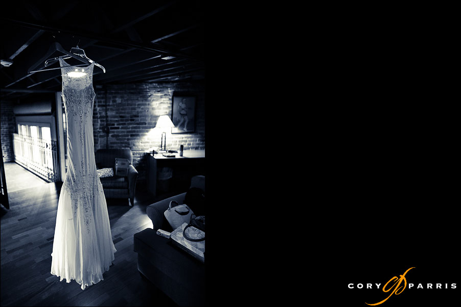 dress on a hanger at the georgetown ballroom by seattle wedding photojournalist cory parris
