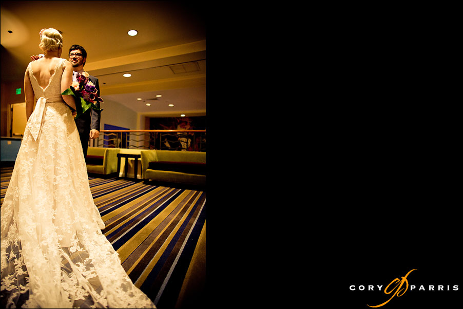 bride and groom seeing each other for the first time in hotel deca by seattle wedding photojournalist cory parris