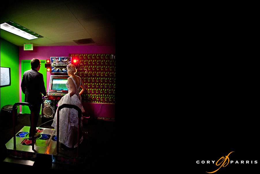 bride and groom playing dance dance revolution in the pink gorilla by seattle wedding photographer cory parris