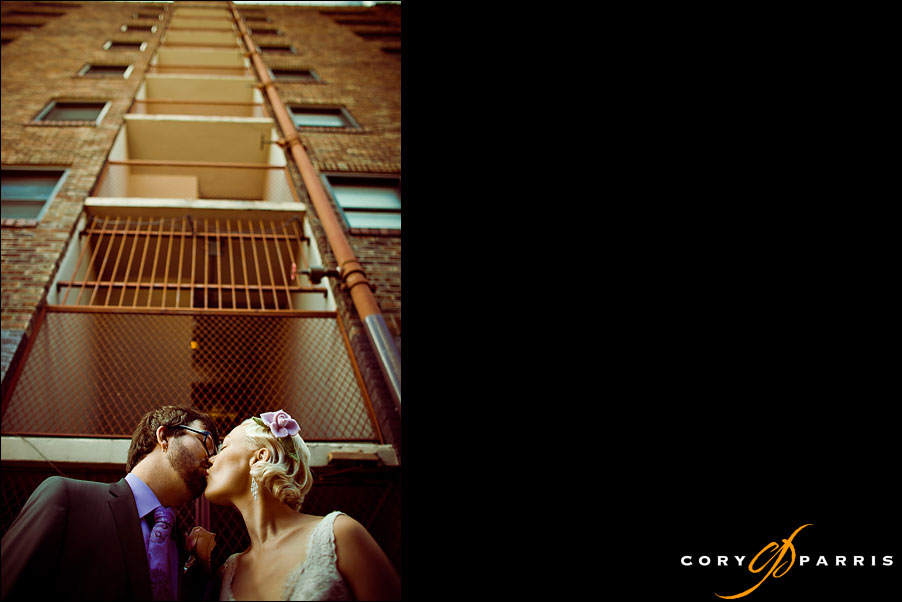 bride and groom kissing in an alley near the university of washington by seattle wedding photographer cory parris