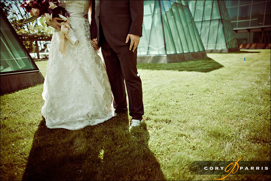 bride and groom holding hands by seattle wedding photographer cory parris