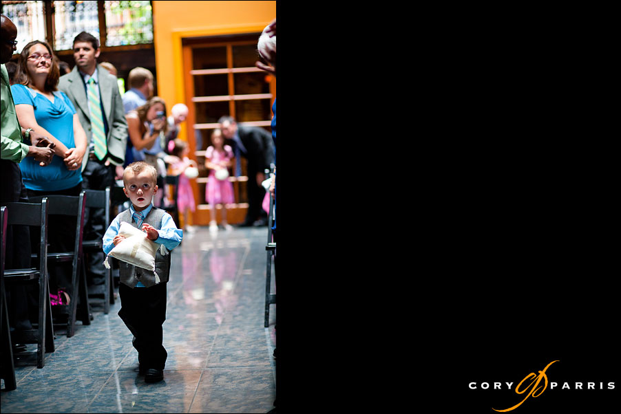 ring bearer walking down the aisle at the georgetown ballroom wedding in seattle