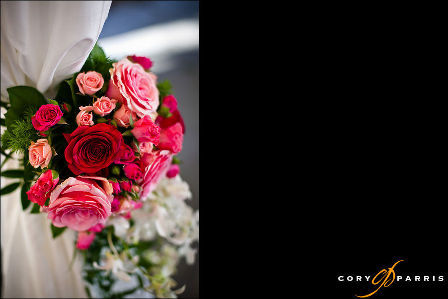 ceremony flowers in pink and red by seattle wedding photographer cory parris