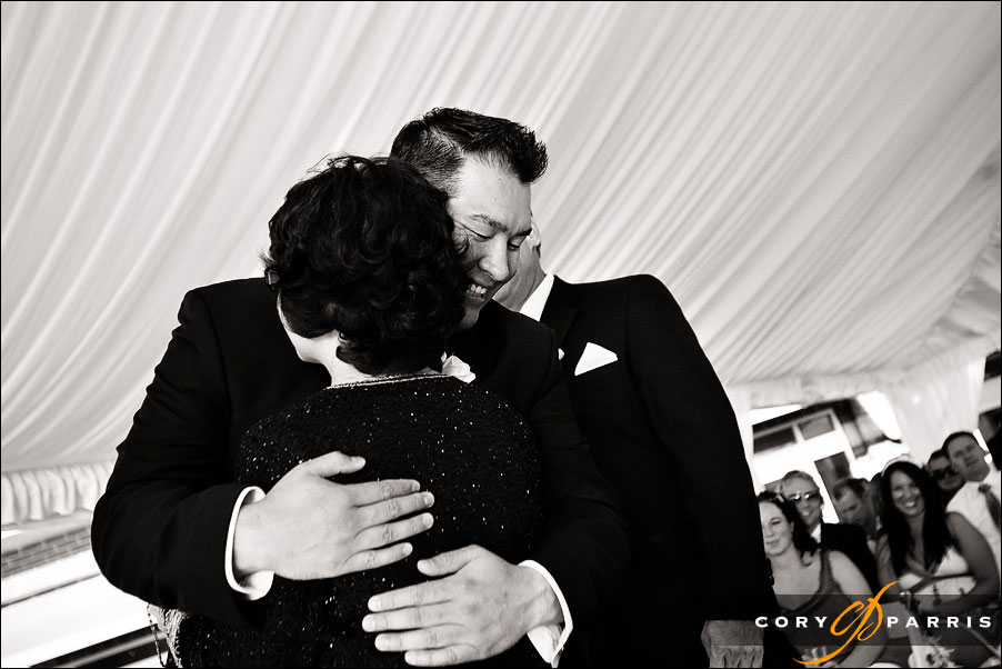 groom hugging his mom during a wedding