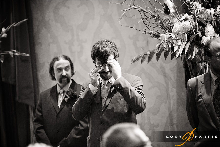 groom wiping eyes during wedding ceremony by seattle wedding photojournalist cory parris