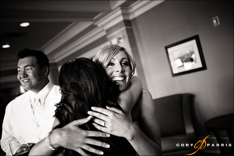 bride hugging guest by seattle wedding photojournalist cory parris