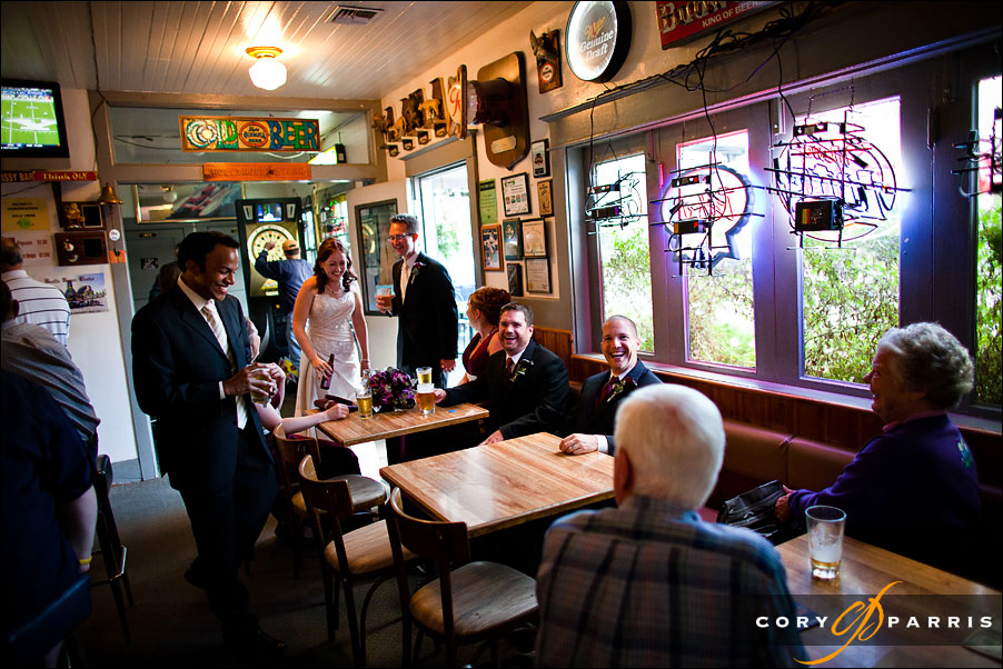 bride and groom in bar by seattle wedding photojournalist cory parris