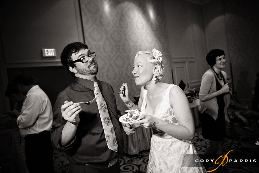 bride and groom tasting the cake by seattle wedding photojournalist cory parris