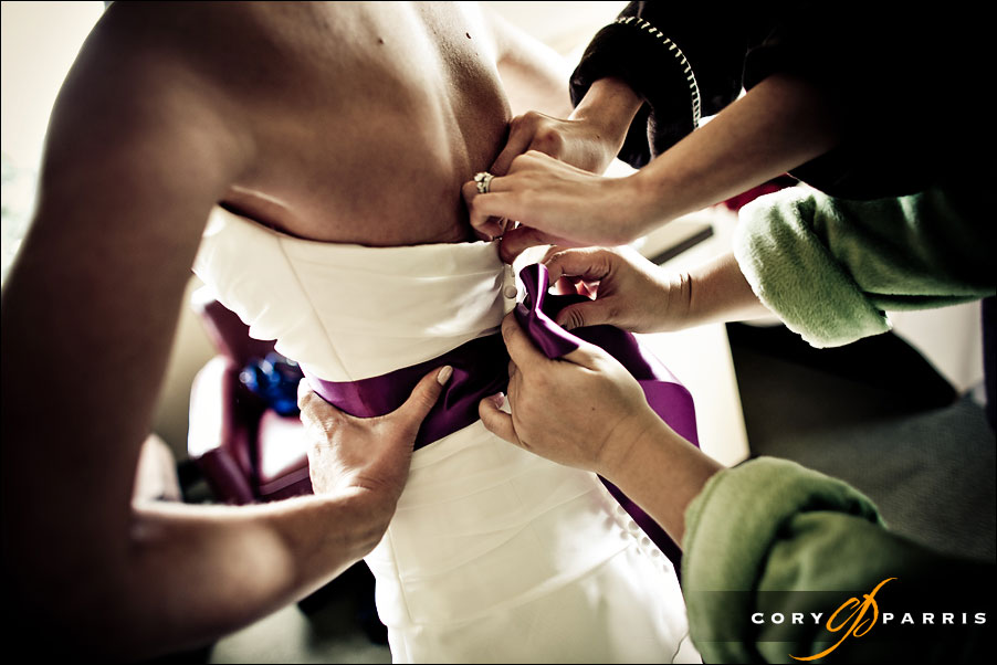 purple ribbon on wedding dress bride getting ready by seattle wedding photojournalist cory parris