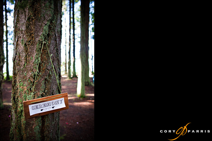 ceremony sign in the woods by seattle wedding photojournalist cory parris