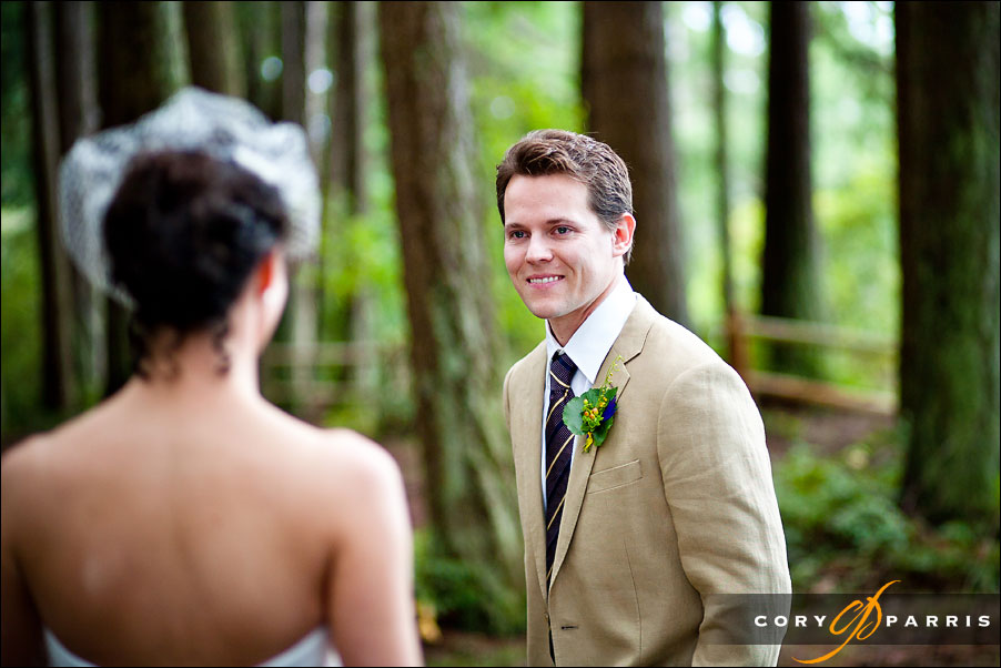 groom seeing bride for the first time in the woods by seattle wedding photojournalist cory parris