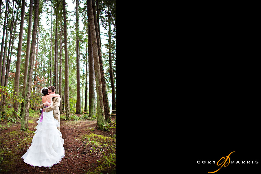 bride and groom hugging in the woods by seattle wedding photographer cory parris