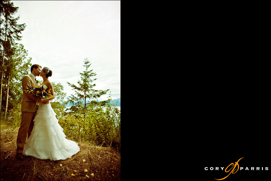 bride and groom portrait on top of a bluff overlooking the ocean by seattle wedding photographer cory parris
