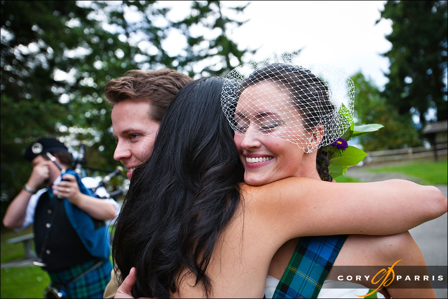 bride hugging maid of honor by seattle wedding photojournalist cory parris
