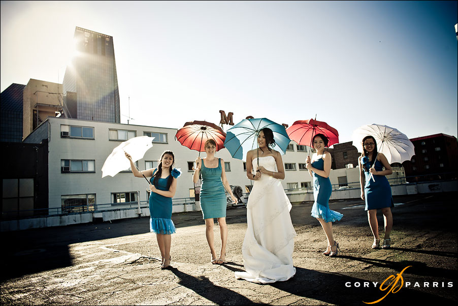 bridesmaids with colored umbrellas in red white and blue