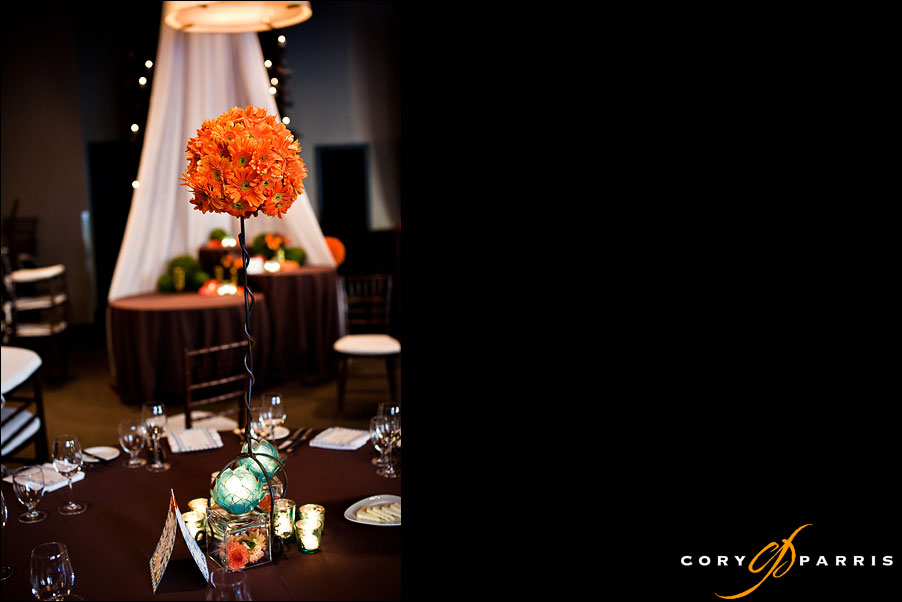 wedding decor with orange flowers and alice in wonderland theme