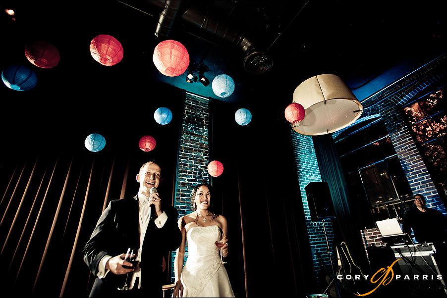 bride and groom toasting their guests at the palace ballroom in seattle