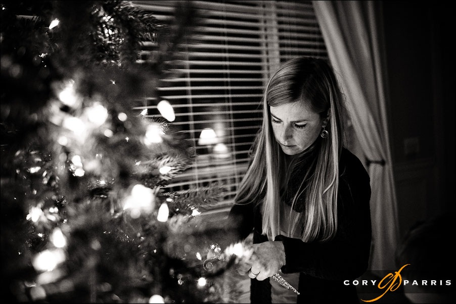 beautiful woman decorating a christmas tree by seattle wedding photographer cory parris