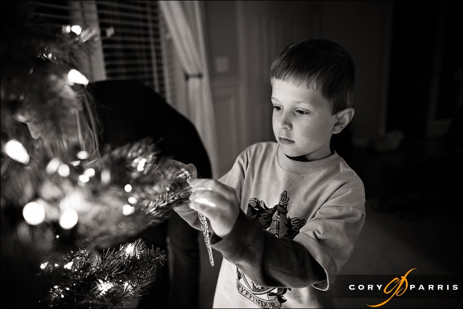Cute little boy decorating a chrstmas tree by seattle wedding photographer cory parris