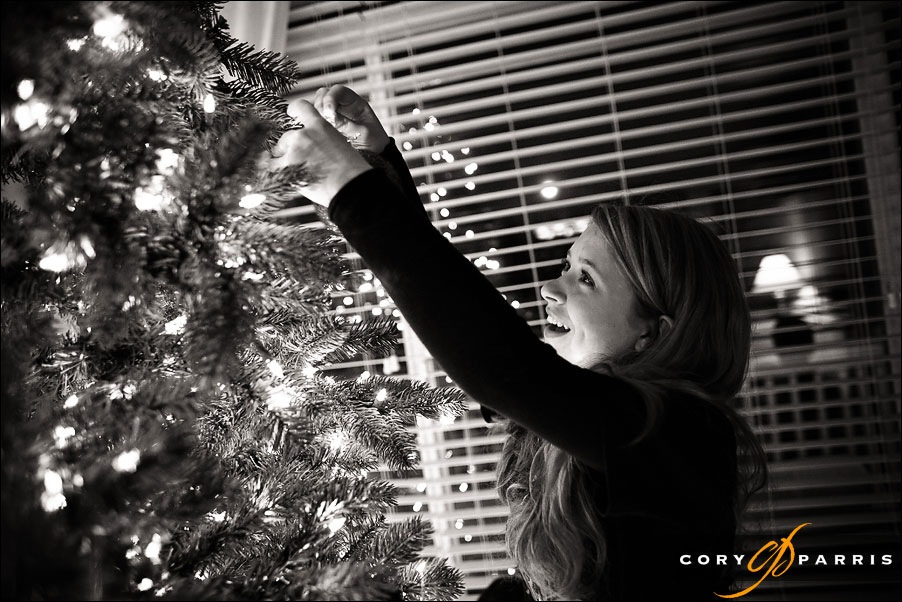 teenage girl decorating a christmas tree by seattle wedding photojournalist cory parris