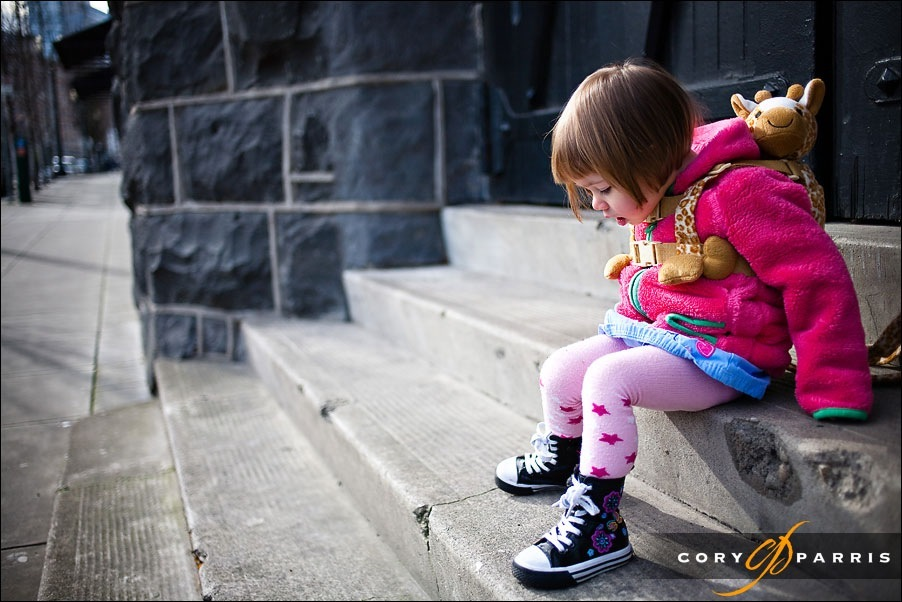 little girl by black door by seattle portrait photographer cory parris