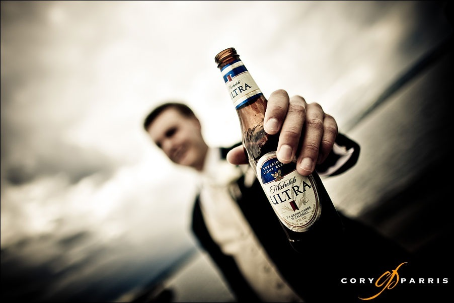 groom and beer at woodmark hotel by seattle wedding photographer cory parris