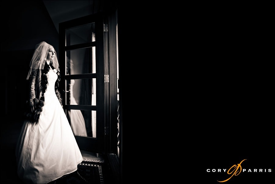 bride at a window at hotel bellevue by seattle wedding photographer cory parris