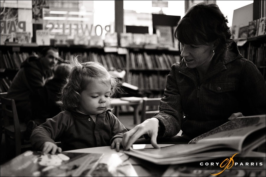 little girl reading a book with mommy by seattle portrait photographer cory parris