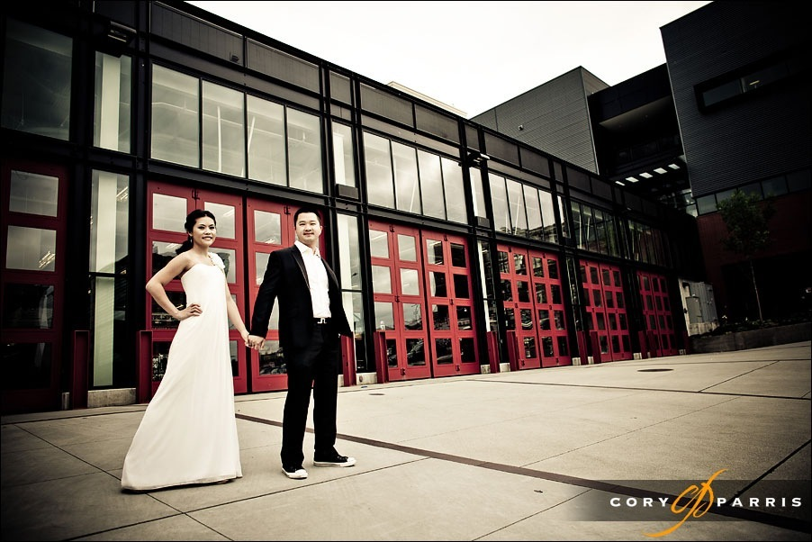 wedding couple in front of the seattle fire station by seattle wedding photographer cory parris