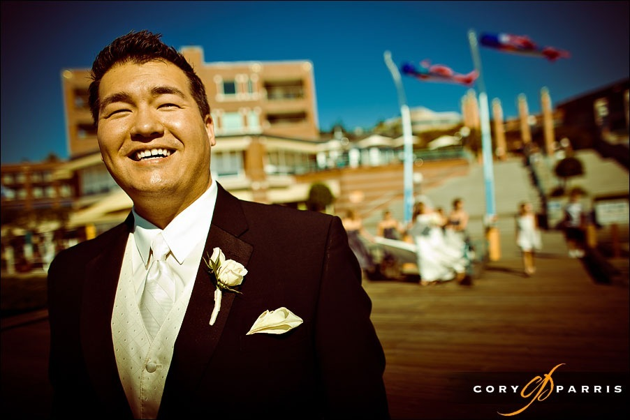 groom waiting to see bride on the dock at the woodmark hotel by seattle wedding photographer cory parris