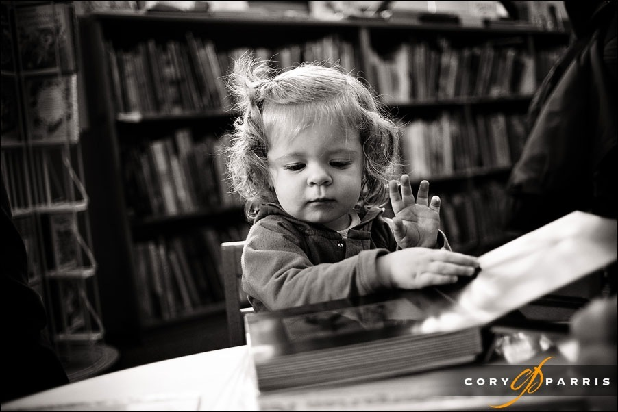 portrait of a toddler reading a book at Powell's in Portland