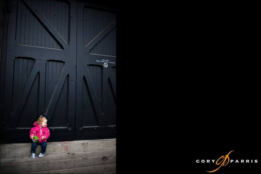 toddler girl with a big black door by seattle wedding photographer cory parris