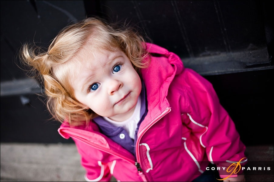 little girl in pink looking up by seattle portrait photographer cory parris