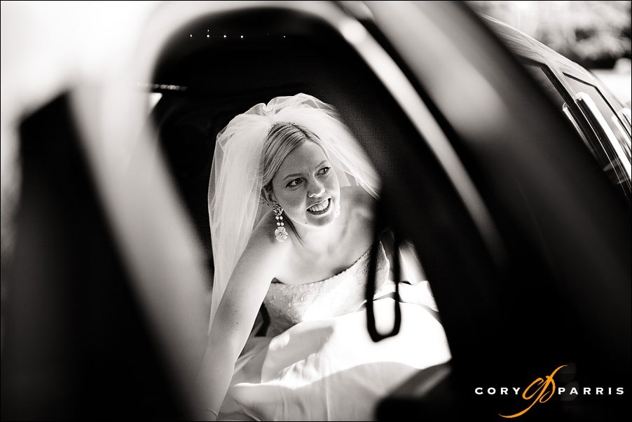 bride watching through one way glass by seattle wedding photographer cory parris