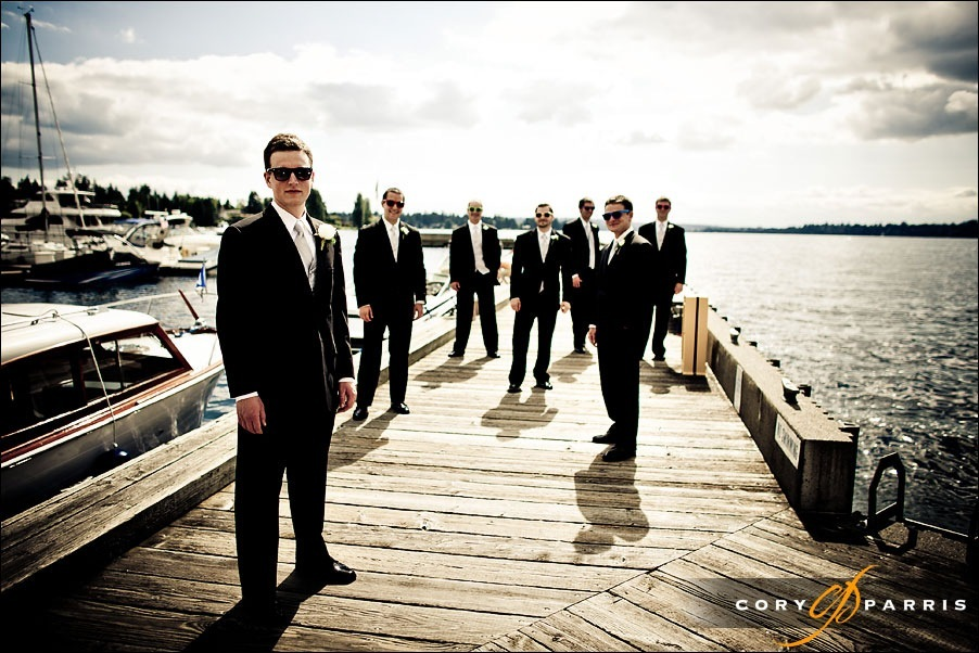 groomsmen on the dock at woodmark hotel by kirkland wedding photographer cory parris