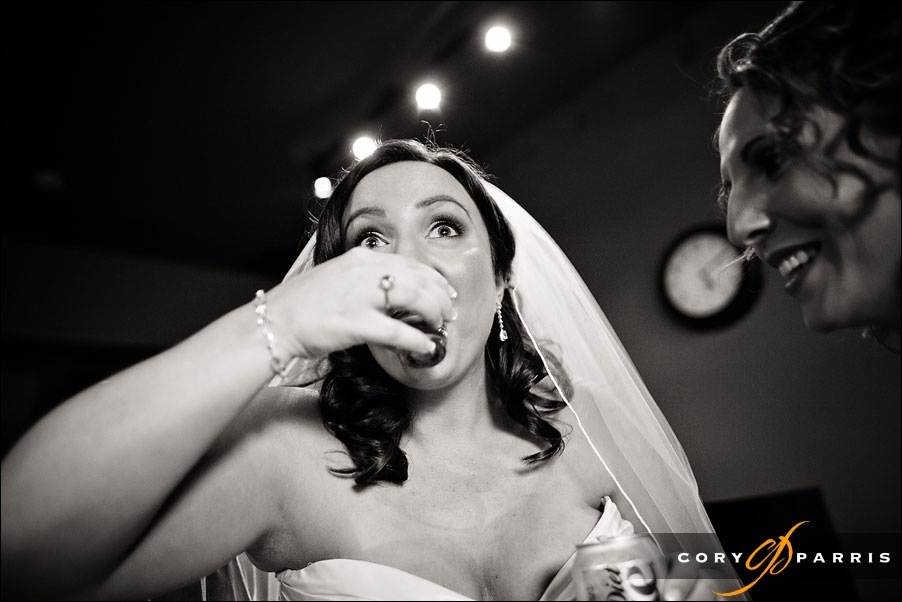 bride drinking tequila at willows lodge by woodinville wedding photographer cory parris