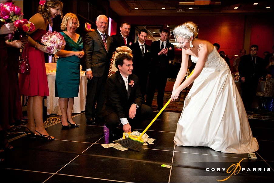 bride and groom sweeping up cash by seattle wedding photographer cory parris