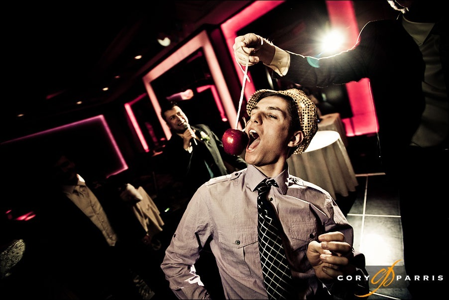 wedding guest bobbing for apple by seattle wedding photographer cory parris