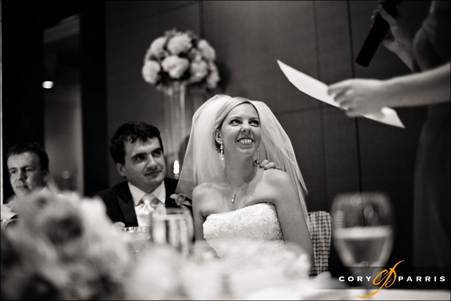 bride listening to toast by seattle wedding photographer cory parris