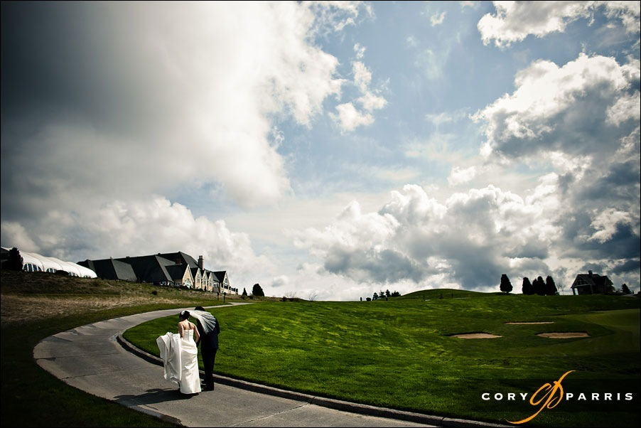 bride and groom walking newcastle  golf club by seattle wedding photographer cory parris