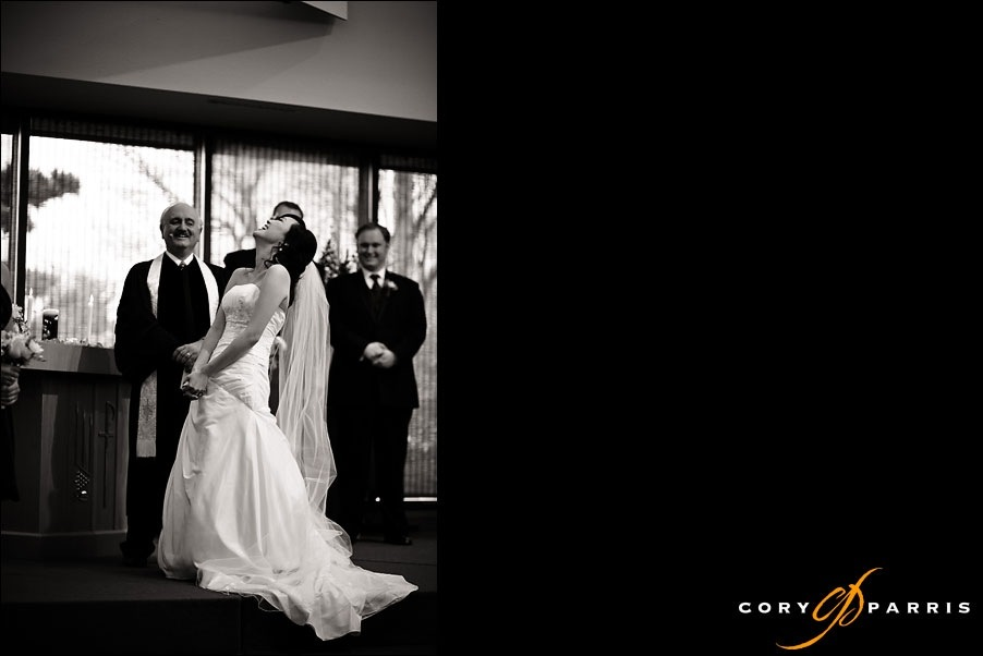 bride laughing as the groom raps her a wedding song by seattle wedding photojournalist cory parris