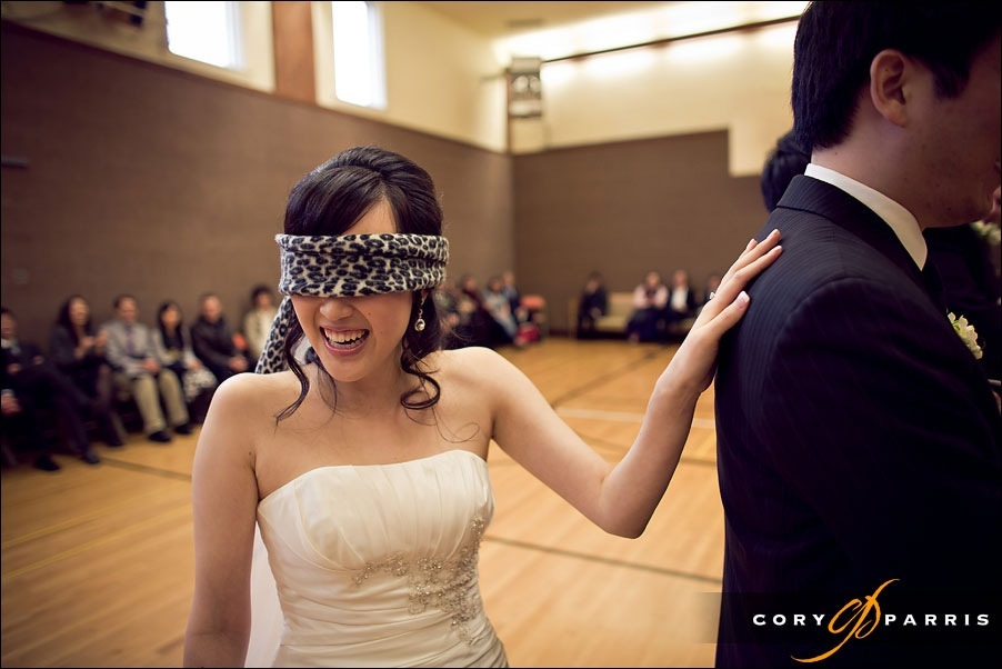 bride during wedding game by seattle wedding photojournalist cory parris