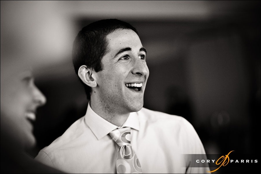 wedding guest laughing by bellevue wedding photographer cory parris